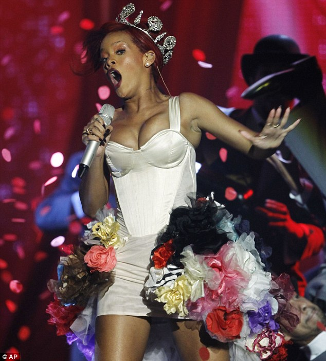 Stealing the show: Rihanna looked dangerously close to losing her top as performed at the MTV European Music Awards last night after learning her new single Only Girl (In The World) had hit No.1 in the UK charts