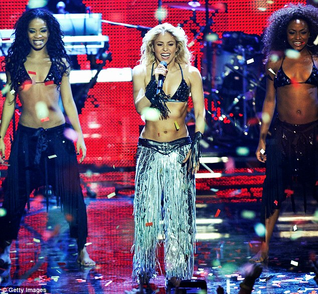 It's all in the hips: Shakira opened the show and true to form put her rock hard stomach firmly on display