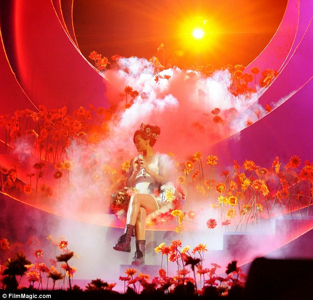 Atmospheric: The singer performed on a fairytale set, complete with flowers, smoke and a sunset backdrop