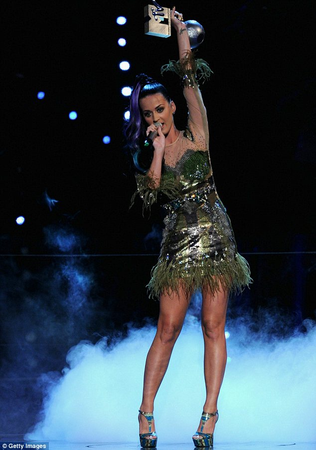 Celebrations: She won an award for Best Video for her lively song California Gurls, seen here holding it aloft after collecting it on stage