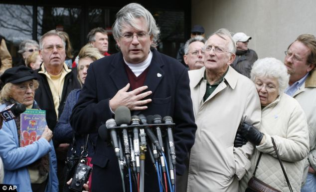 Brave: Dr William Petit, sole survivor of the home invasion massacre, addresses the media outside New Haven court today