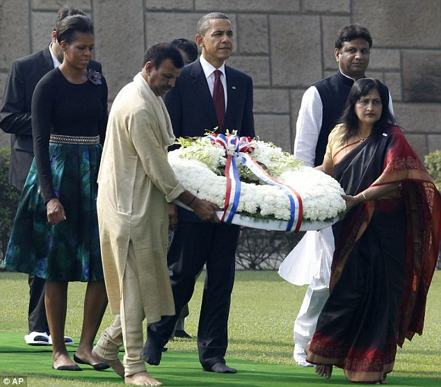 The Obamas took off their shoes to lay a wreath at Raj Ghat, the Mahatma Gandhi memorial in New Delh, earlier in the day