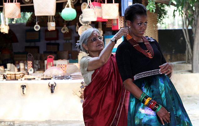 The First Lady tried on a beaded necklace at the National Crafts Museum and ended up buying an armful of bracelets, perhaps for daughters Sasha and Malia, who did not come along on the trip to Asia