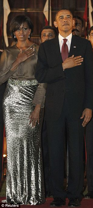 U.S. President Barack Obama and first lady Michelle Obama listen to their national anthem as they attend a state dinner at Rashtrapati Bhavan
