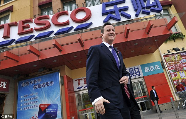 Popping to the shops: David Cameron traveled half way around the world to China and his first port of call was...Tesco. The Prime Minister arrived in China as part of Britain's largest-ever delegation to the country with fifty top business leaders