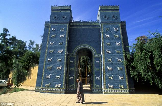 A man walks past The Ishtar Gate, in Babylon, Iraq