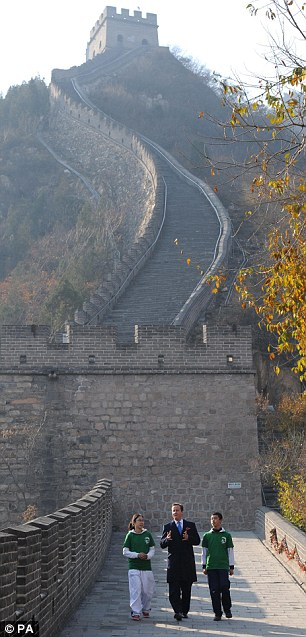 David Cameron is shown the Great Wall of China by students from Beijing on the second of a two day trip to China