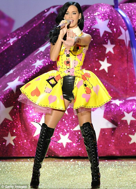 In control: Katy, seen performing at a Victoria's Secret show last night, makes the rules in the Perry-Brand household