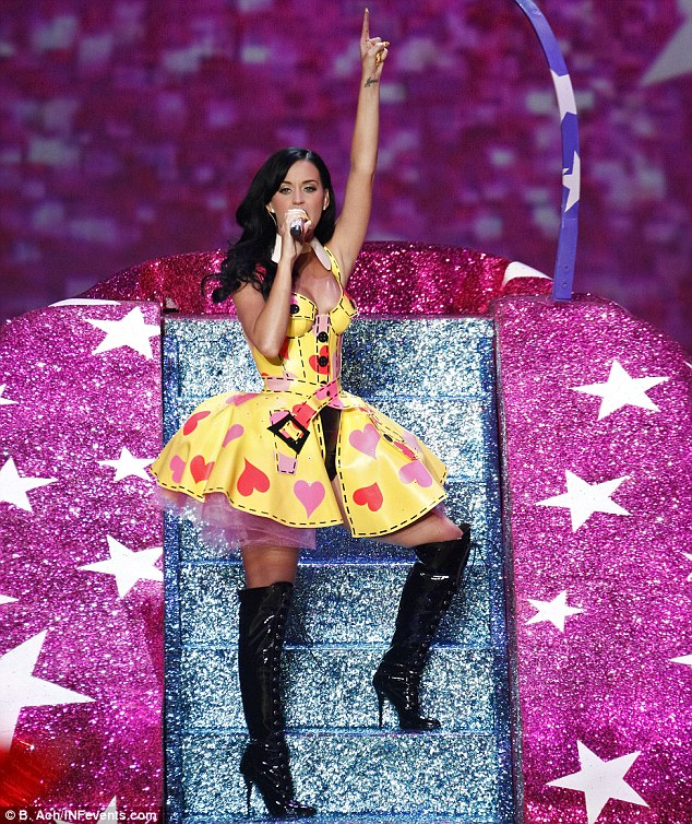 Frock star: The singer changed into a PVC dress and thigh-high black boots