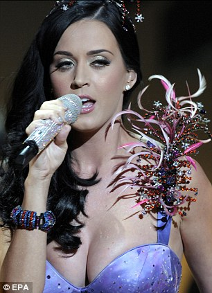 Cup runneth over: Katy donned an incredibly low-cut purple bustier