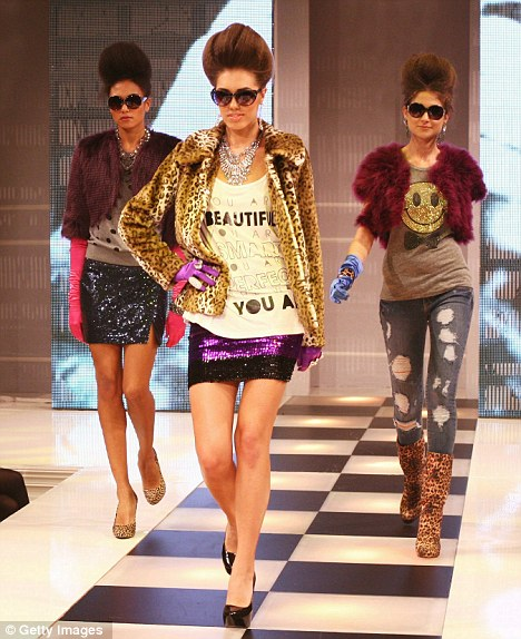 Trend-led: Amber leads models on the catwalk at the European launch of Forever 21, which offers fast fashion at value prices