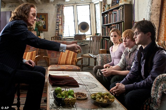 Screen icons: Radcliffe, Grint and Watson in a scene from Harry Potter and the Deathly Hallows : Part 1 with co-star Bill Nighy, who plays Rufus Scrimgeour