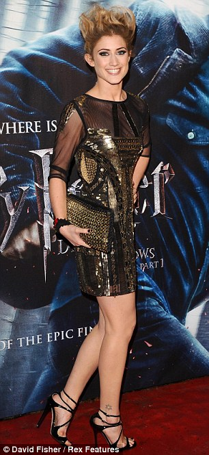 Dressing up: X Factor contestants Katie Waissel, wearing an intricate gold dress with sheer black panelling