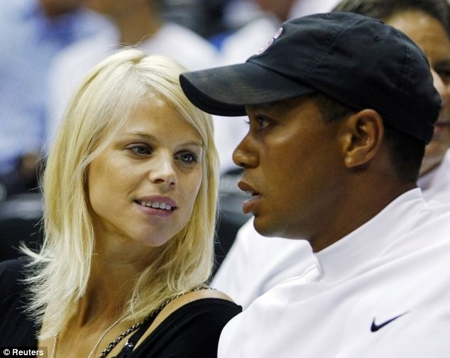 Broken marriage: Elin and Tiger divorced in August following the scandal sparked by Rachel's texts to the golfer