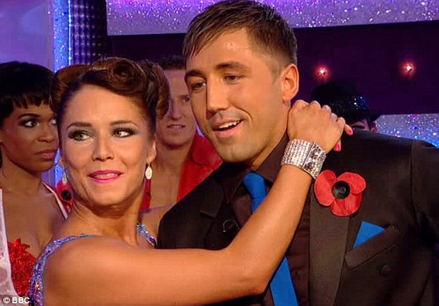 Delighted: Katya Virshilas and Gavin were thrilled to bits to get their best score yet after the rugby player had planted a smacker on judge Bruno's lips