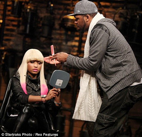 Finishing touches: Minaj has her hair touched up by her stylist