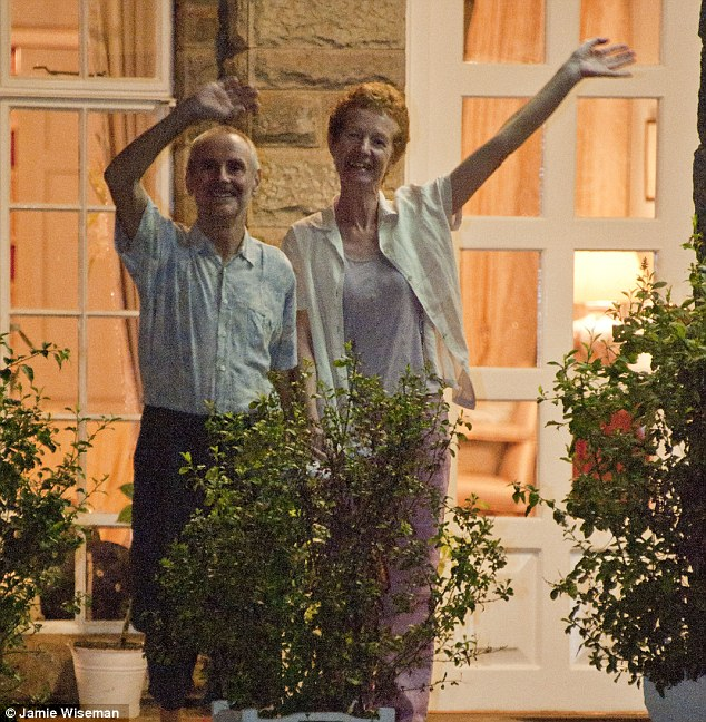 Rescued: The couple wave from the steps of the British High Commissioner's residence in Nairobi