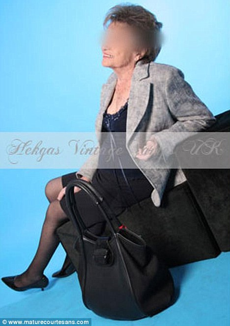 High class: Sheila poses with her handbag as she reclines against a couple of square cushions