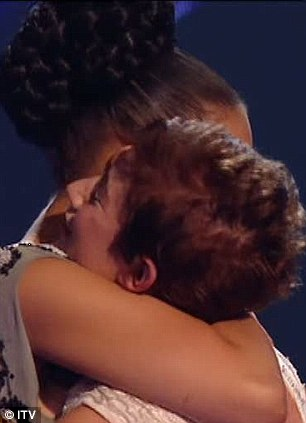 Shock: Katie was the first act to be told she was safe and looked incredibly shocked upon hearing her name, seen right launching into a hug with Rebecca Ferguson