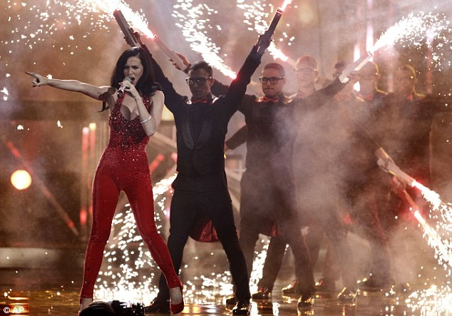 Sparky: Katy Perry performed her new hit Firework wearing a sparkling red catsuit
