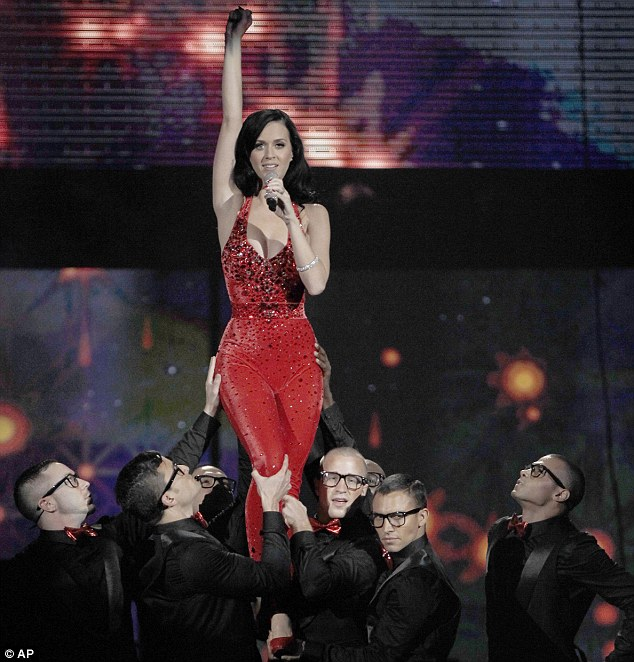 High lift: Perry ended her performance when she was lifted up by her make backing dancers