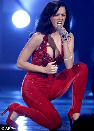 The cat's whiskers: The star performed in a tight red catsuit