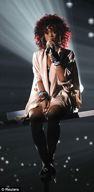 Demure to diva: Rihanna perched in the air before writhing into an energetic performance