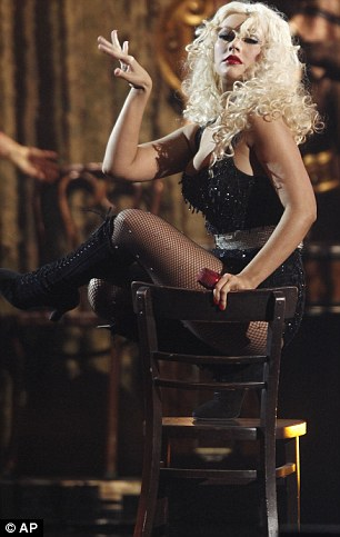 Showstopper: The singer performed the dramatic number on a set designed to look like backstage at a Burlesque club