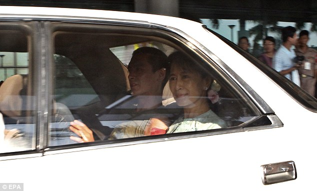 Difficult: Ms Suu Kyi, who won the 1991 Nobel Peace prize for her non-violent struggle for democracy, was first arrested in 1989 when Kim was 11 and elder son Alexander 16, and admitted that a life in politics has been hard on her family