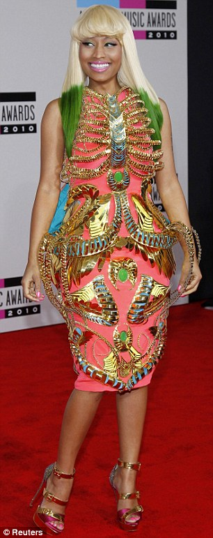 Undcided: US rapper Nicki Minaj looks torn about her elaborate dress by Indian designer Manish Arora at the American Music Awards