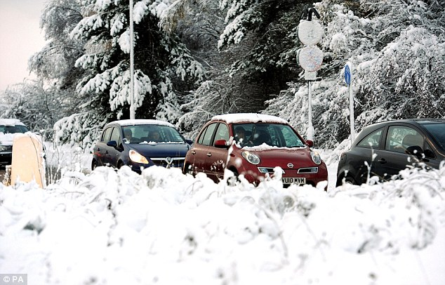 Welcome to winter: Parts of Britain woke to inches of snow and icy roads yesterday, reducing roads such as the A1 in Newcastle (pictured) to a crawl