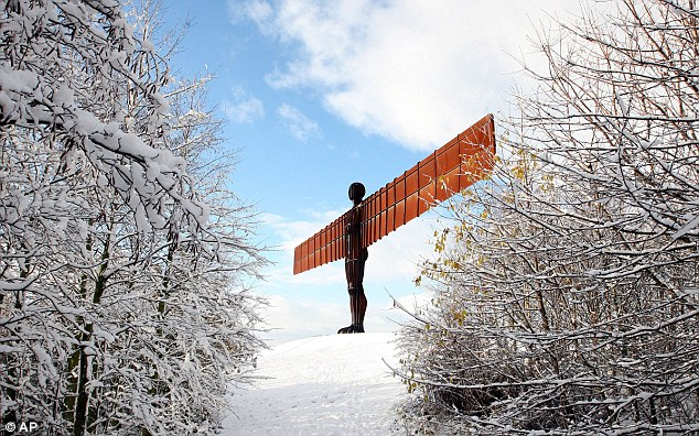 The Angel of the North statue in Gateshead has added visual impact  through the snow-covered trees