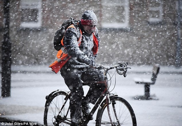 Fierce chill: Blizzards in York make the ride home from work uncomfortable