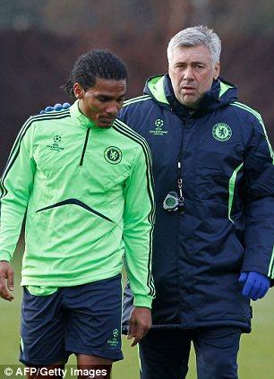 Carlo Ancelotti (R) talks to Chelsea's French footballer Florent Malouda