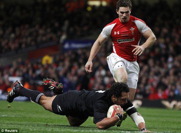 Nice John: New Zealand's John Afoa (L) dives past Wales' George North to score