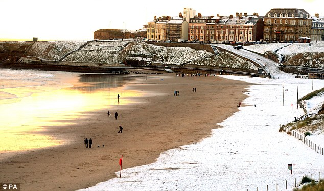 Sun, sand, sea... and snow: The beach at Tynemouth is covered in snow today