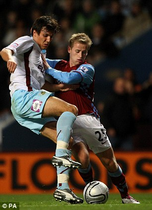 On the ball: Cork (left) scored an injury-time winner