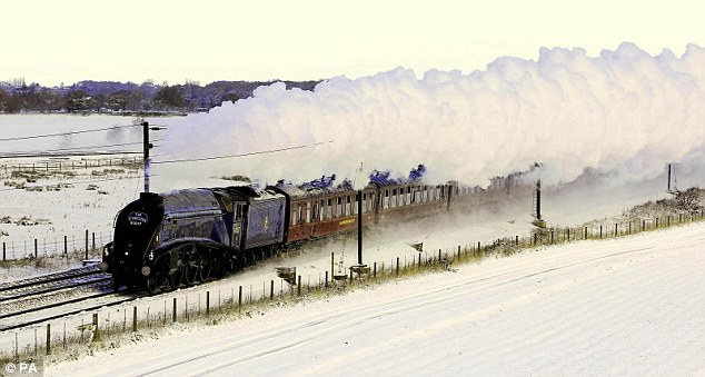 Classic scene: The Sir Nigel Gresley steam engine makes it's way through a snow covered tracks in York today