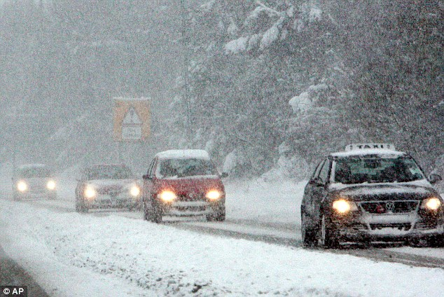 Blanket: Police are advising motorists to stay off the roads as parts of Britain get set for 15 inches of snow