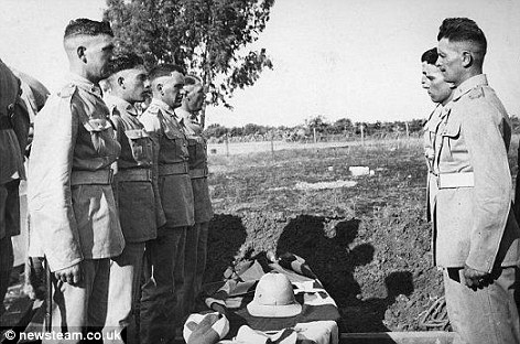 Killed: Soldiers pay their respects at burial ceremony of the real life Harry Potter after he was killed during an uprising in 1939