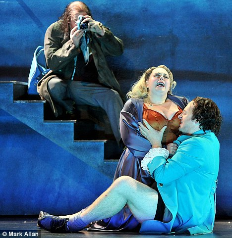 Don Giovanni assaults Donna Anna, played by Katherine Broderick