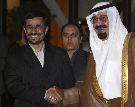 Iranian President Mahmoud Ahmadinejad with King Abdullah: The Saudi king has urged American to launch airstrikes against Iranian nuclear facilities