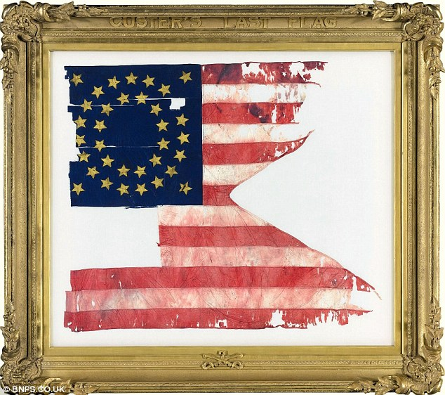 Up for auction: This bloodstained flag was with General Custer when his troops were massacred by Native Americans at the Battle Of The Little Bighorn in 1876. It is estimated to sell for at least £3.5million