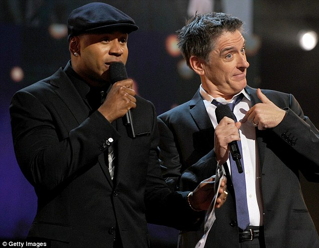 Fronting the show: Host LL Cool J (left) stands with late night show presenter Craig Ferguson on the stage