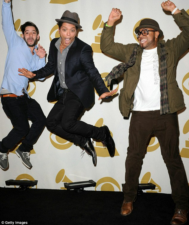 Jumping for joy: Songwriter/producers Ari Levine, Bruno Mars and Philip Lawrence from production team The Smeezingtons celebrate their nominations