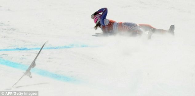 Awful landing: Alcott crashes in a heap on the slope