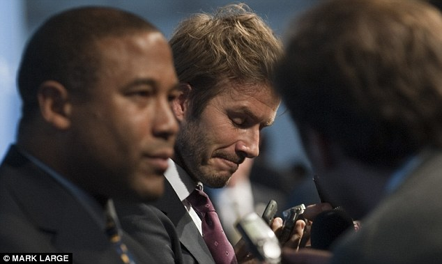 End of the world: Beckham grimaces as the result is announced