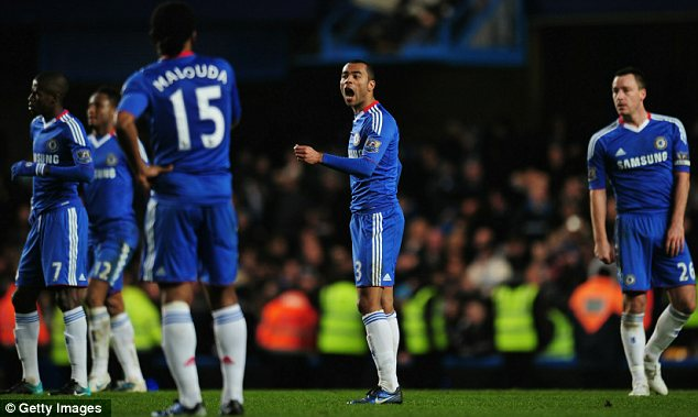 Shouting match: Ashley Cole starts the inquest after Everton's equaliser