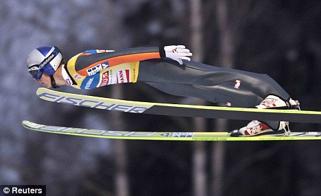 Fabulous performance: Thomas Morgenstern soars through the air in Lillehammer