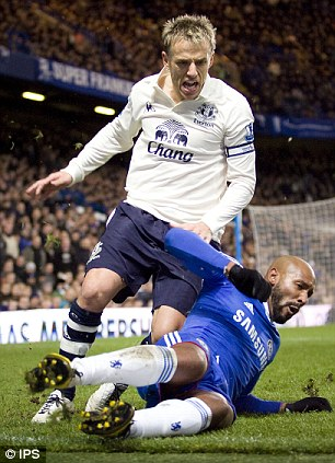 Fightback: Anelka challenges Neville - who was involved in a spat with Malouda